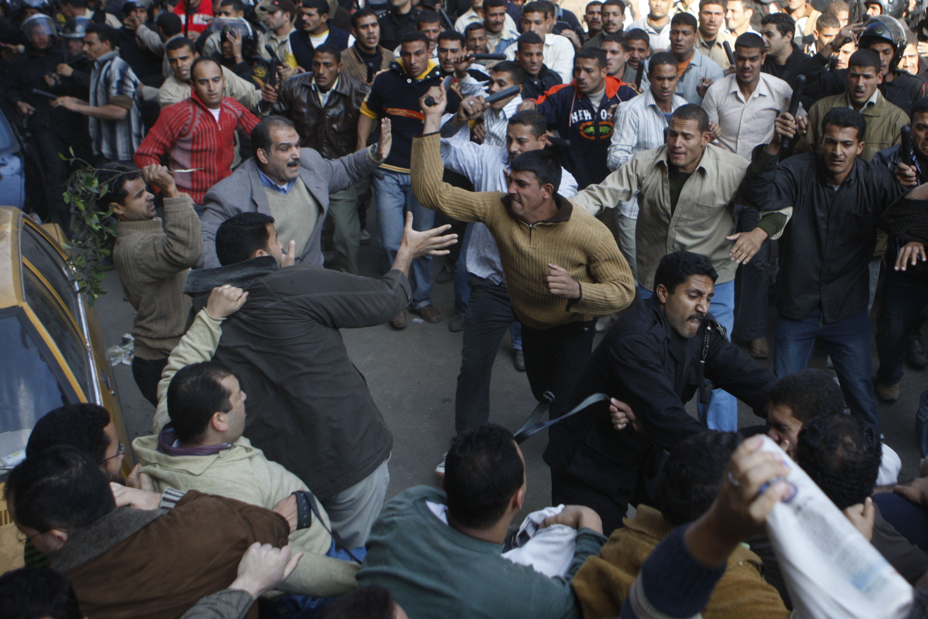 Plainclothes Police thugs assault pro-Gaza protesters in Ramses Square. Photo by Nasser Nouri, taken on 2 December 2008